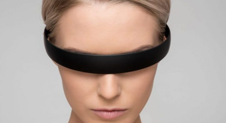 Woman with dark glasses required to protect the eyes during infrared LED treatment