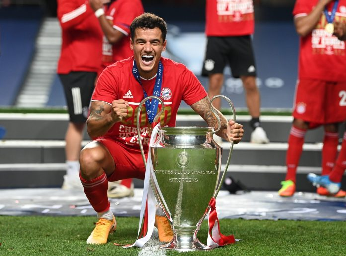 ISBON, PORTUGAL - AUGUST 23: Philippe Coutinho of FC Bayern Munich celebrates with the UEFA Champions League Trophy following his team's victory in the UEFA Champions League Final match between Paris Saint-Germain and Bayern Munich at Estadio do Sport Lisboa e Benfica on August 23, 2020 in Lisbon, Portugal.