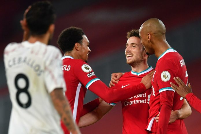 LIVERPOOL, ENGLAND - SEPTEMBER 28: Diogo Jota of Liverpool celebrates with teammates after scoring his sides third goal during the Premier League match between Liverpool and Arsenal at Anfield on September 28, 2020 in Liverpool, England.