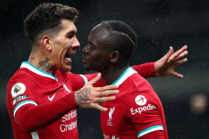 LONDON, ENGLAND - JANUARY 28: Sadio Mane of Liverpool celebrates with teammate Roberto Firminho after scoring his team's third goal during the Premier League match between Tottenham Hotspur and Liverpool at Tottenham Hotspur Stadium on January 28, 2021 in London, England.