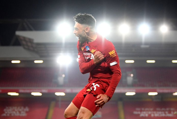 LIVERPOOL, ENGLAND - JULY 22: Alex Oxlade-Chamberlain of Liverpool celebrates after scoring his team's fifth goal during the Premier League match between Liverpool FC and Chelsea FC at Anfield on July 22, 2020 in Liverpool, England.