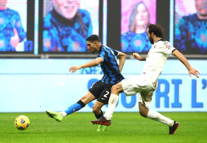Achraf Hakimi of Inter Milan scores their team's first goal during the Serie A match between FC Internazionale and Spezia Calcio at Stadio Giuseppe Meazza on December 20, 2020 in Milan, Italy.