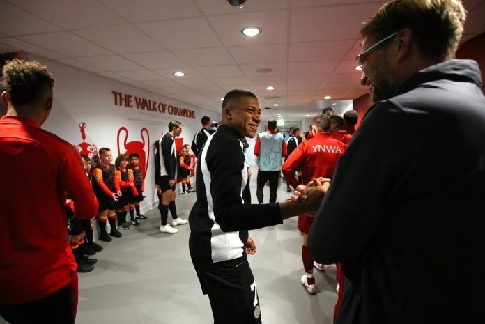 LIVERPOOL, ENGLAND - SEPTEMBER 18: Kylian Mbappe of Paris Saint-Germain shakes hands with Jurgen Klopp the manager of Liverpool in the tunnel prior to the Group C match of the UEFA Champions League between Liverpool and Paris Saint-Germain at Anfield on September 18, 2018 in Liverpool, United Kingdom.