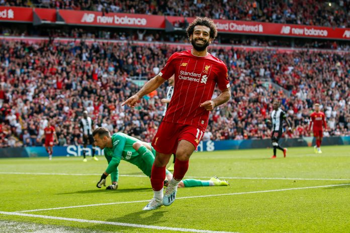 LIVERPOOL, ENGLAND - SEPTEMBER 14: Mohamed Salah of Liverpool celebrates after scoring his side's third goal to make the score 3-1 during the Premier League match between Liverpool FC and Newcastle United at Anfield on September 14, 2019 in Liverpool, United Kingdom.