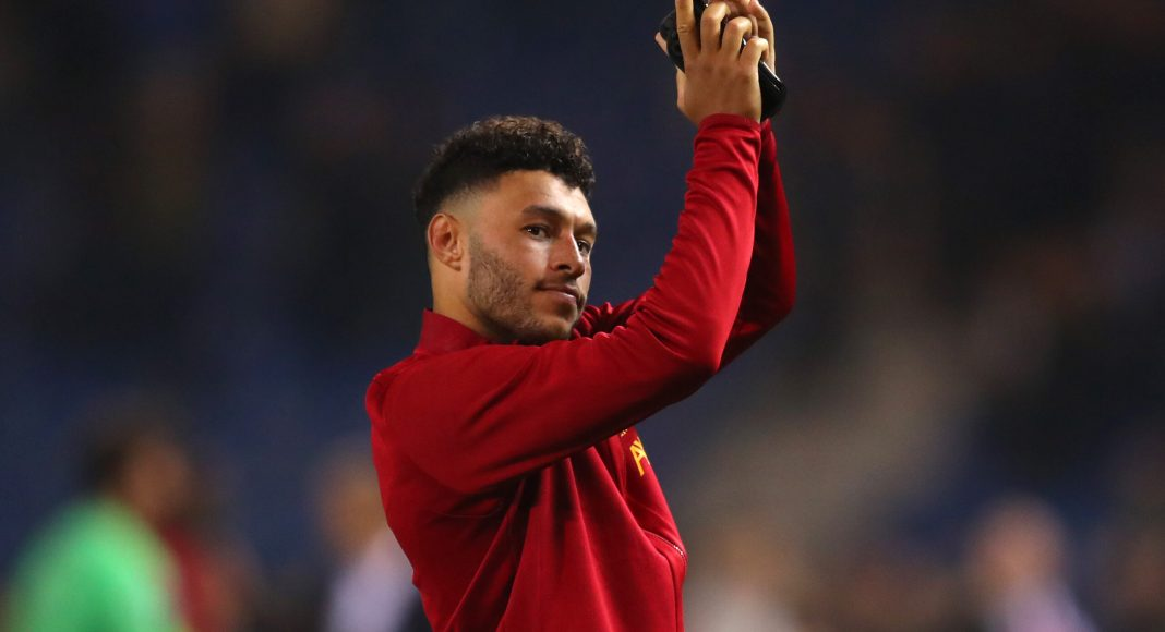 GENK, BELGIUM - OCTOBER 23: Alex Oxlade-Chamberlain of Liverpool applauds fans after the UEFA Champions League group E match between KRC Genk and Liverpool FC at Luminus Arena on October 23, 2019 in Genk, Belgium.