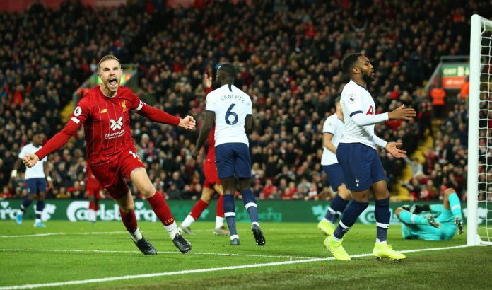 LIVERPOOL, ENGLAND - OCTOBER 27: Jordan Henderson of Liverpool (L) celebrates after scoring his team's first goal during the Premier League match between Liverpool FC and Tottenham Hotspur at Anfield on October 27, 2019 in Liverpool, United Kingdom.