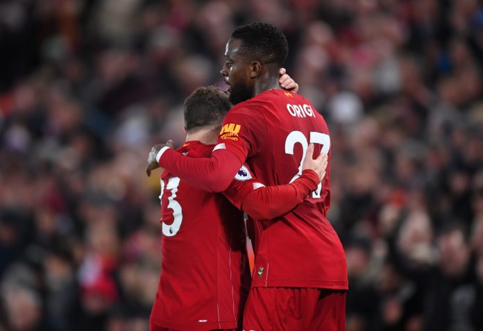 LIVERPOOL, ENGLAND - DECEMBER 04: Divock Origi of Liverpool celebrates with teammate Xherdan Shaqiri after scoring his team's third goal during the Premier League match between Liverpool FC and Everton FC at Anfield on December 04, 2019 in Liverpool, United Kingdom.