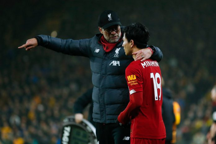 WOLVERHAMPTON, ENGLAND - JANUARY 23: Jurgen Klopp the head coach / manager of Liverpool and Takumi Minamino of Liverpool during the Premier League match between Wolverhampton Wanderers and Liverpool FC at Molineux on January 23, 2020 in Wolverhampton, United Kingdom.