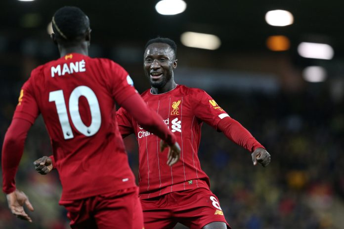 NORWICH, ENGLAND - FEBRUARY 15: Naby Keita of Liverpool celebrates the only goal of the match with goalscorer Sadio Mane during the Premier League match between Norwich City and Liverpool FC at Carrow Road on February 15, 2020 in Norwich, United Kingdom.