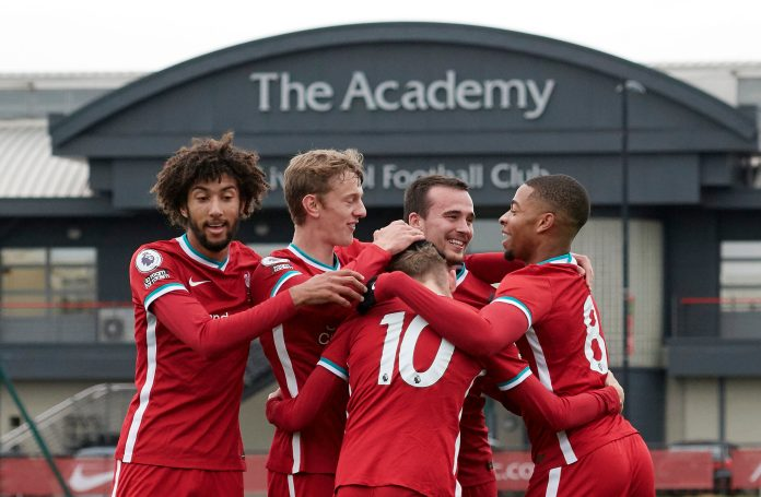 KIRKBY, ENGLAND - OCTOBER 24: (THE SUN OUT, THE SUN ON SUNDAY OUT) Jake Cain (10) of Liverpool celebrates scoring Liverpool's second goal with team mates Remi Savage, Tom Clayton, Liam Millar and Elijah Dixon-Bonner during the PL2 game at The Kirkby Academy on October 24, 2020 in Kirkby, England.
