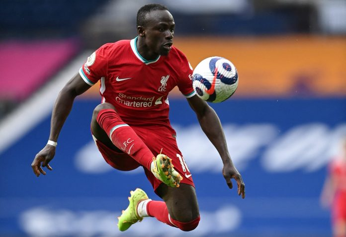 Liverpool's Senegalese striker Sadio Mane controls the ball during the English Premier League football match between West Bromwich Albion and Liverpool at The Hawthorns stadium in West Bromwich, central England, on May 16, 2021.
