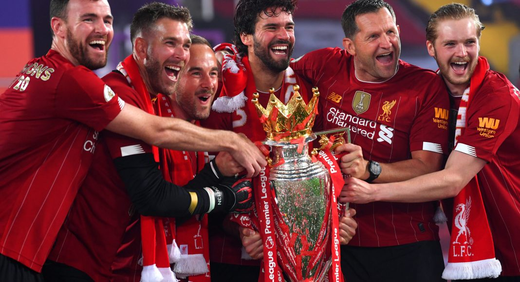 LIVERPOOL, ENGLAND - JULY 22: (L-R) Andy Lonergan, Adrian, Jack Robinson, Assistant Goalkeeping Coach, Alisson Becker, John Achterberg, Goalkeeping Coach and Caoimhin Kelleher of Liverpool celebrate with The Premier League trophy following the Premier League match between Liverpool FC and Chelsea FC at Anfield on July 22, 2020 in Liverpool, England.