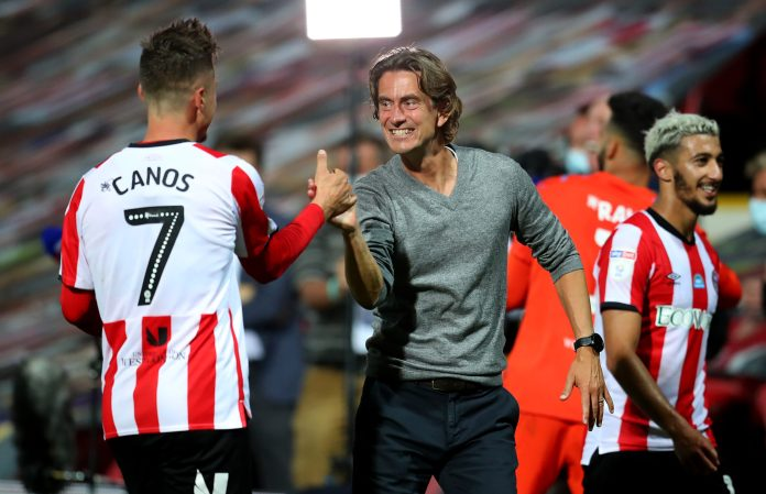 BRENTFORD, ENGLAND - JULY 29: Thomas Frank (R), head coach of Brentford celebrate with team mate Sergi Canós after the Sky Bet Championship Play Off Semi-final 2nd Leg match between Brentford and Swansea City at Griffin Park on July 29, 2020 in Brentford, England.