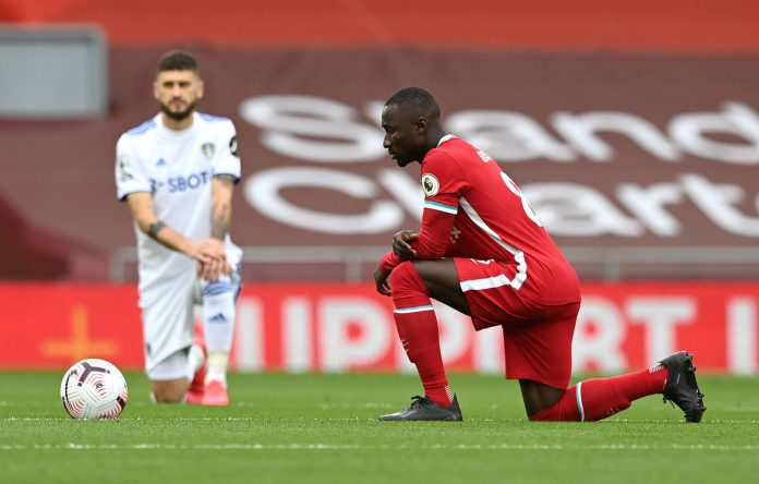 LIVERPOOL, ENGLAND - SEPTEMBER 12: Naby Keita of Liverpool takes a knee in support of the Black Lives Matter movement prior to the Premier League match between Liverpool and Leeds United at Anfield on September 12, 2020 in Liverpool, England.