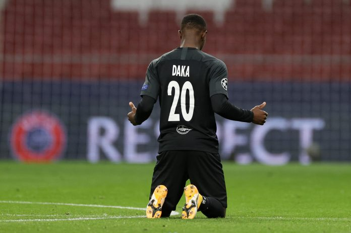 MADRID, SPAIN - OCTOBER 27: Patson Daka of RB Salzburg takes a knee in support of the Black Lives Matter movement during the UEFA Champions League Group A stage match between Atletico Madrid and RB Salzburg at Estadio Wanda Metropolitano on October 27, 2020 in Madrid, Spain.