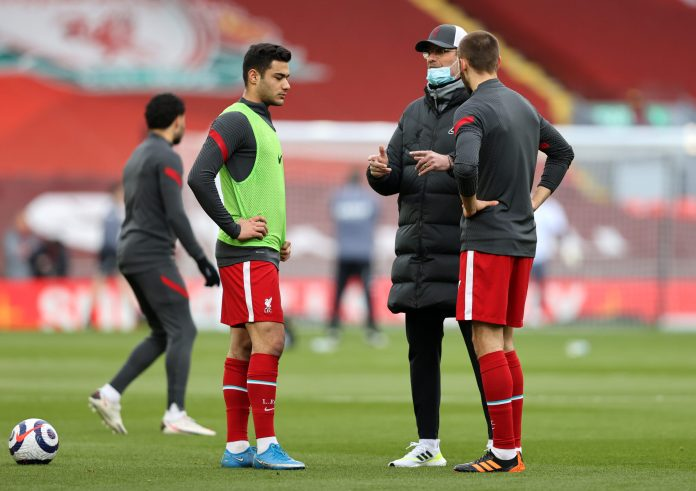 LIVERPOOL, ENGLAND - APRIL 10: Juergen Klopp, Manager of Liverpool interacts with Nathaniel Phillips and Ozan Kabak during the Premier League match between Liverpool and Aston Villa at Anfield on April 10, 2021 in Liverpool, England.
