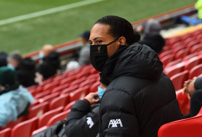 LIVERPOOL, ENGLAND - MAY 23: ( THE SUN OUT,THE SUN ON SUNDAY OUT) Virgil van Dijk of Liverpool in action the crowd during the Premier League match between Liverpool and Crystal Palace at Anfield on May 23, 2021 in Liverpool, England.