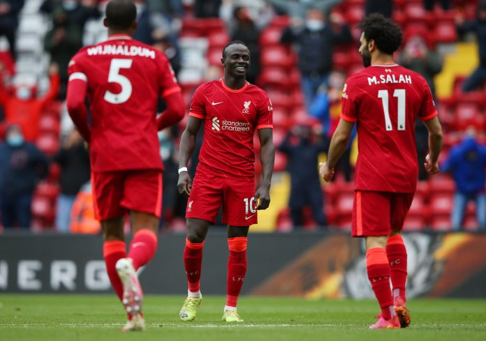 Sadio Mane of Liverpool celebrates after scoring their side's second goal during the Premier League match between Liverpool and Crystal Palace at Anfield on May 23, 2021 in Liverpool, England.