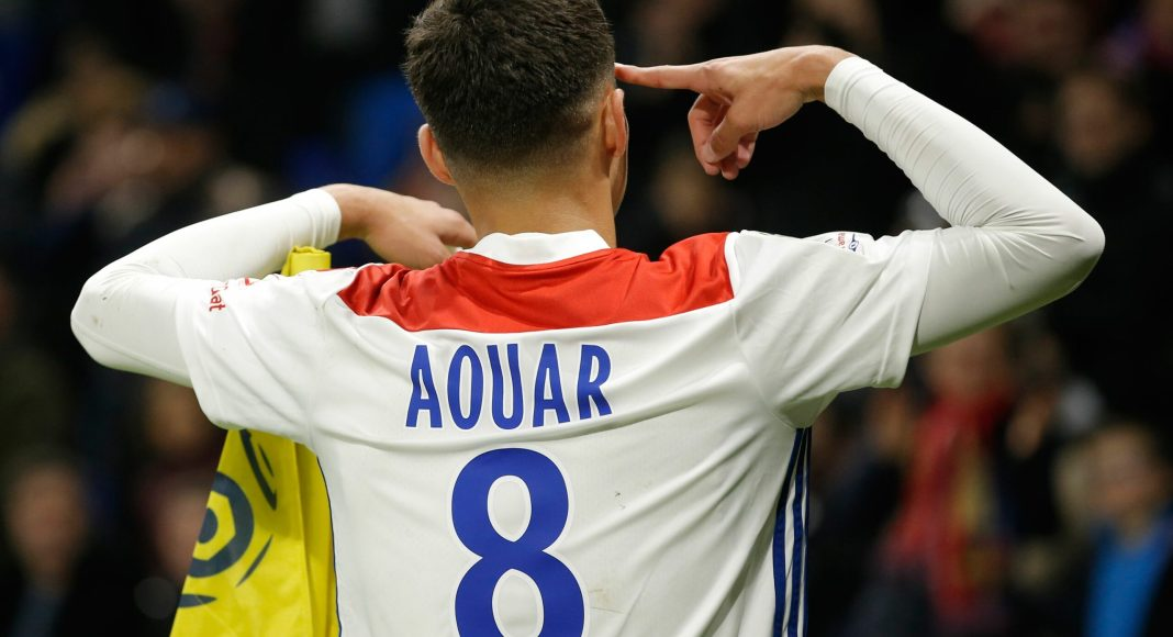 Lyon's French midfielder Houssem Aouar reacts after scoring a goal during the French L1 football match between Olympique Lyonnais and Girondins de Bordeaux on November 3, 2018, at the Groupama Stadium in Decines-Charpieu, central eastern France.