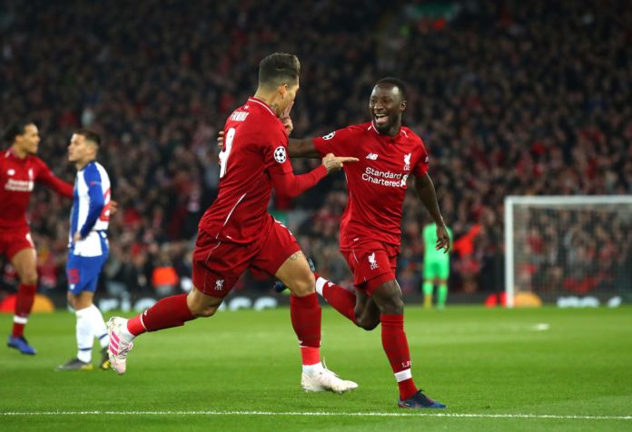 LIVERPOOL, ENGLAND - APRIL 09: Naby Keita of Liverpool celebrates after scoring his team's first goal with Roberto Firmino of Liverpool during the UEFA Champions League Quarter Final first leg match between Liverpool and Porto at Anfield on April 09, 2019 in Liverpool, England. (Photo by Julian Finney/Getty Images)