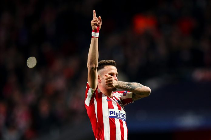 MADRID, SPAIN - FEBRUARY 18: Saul Niguez of Atletico Madrid celebrates after scoring a goal to make it 1-0 during the UEFA Champions League round of 16 first leg match between Atletico Madrid and Liverpool FC at Wanda Metropolitano on February 18, 2020 in Madrid, Spain.