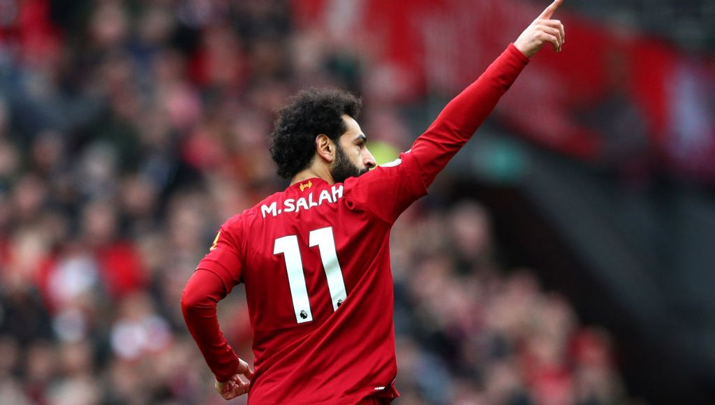 LIVERPOOL, ENGLAND - MARCH 07: Mohamed Salah of Liverpool celebrates after scoring his team's first goal during the Premier League match between Liverpool FC and AFC Bournemouth at Anfield on March 07, 2020 in Liverpool, United Kingdom. (Photo by Jan Kruger/Getty Images)