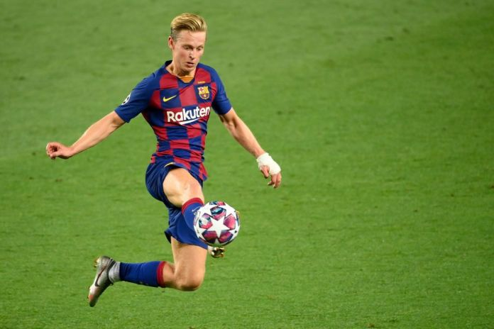 Barcelona's Dutch midfielder Frenkie De Jong controls the ball during the UEFA Champions League round of 16 second leg football match between FC Barcelona and Napoli at the Camp Nou stadium in Barcelona on August 8, 2020. (Photo by LLUIS GENE / AFP) (Photo by LLUIS GENE/AFP via Getty Images)