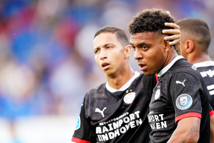 TILBURG, NETHERLANDS - AUGUST 21: Donyell Malen of PSV celebrates 0-1 with Mauro Junior of PSV during the Club Friendly match between Willem II v PSV at the Koning Willem II Stadium on August 21, 2020 in Tilburg Netherlands.