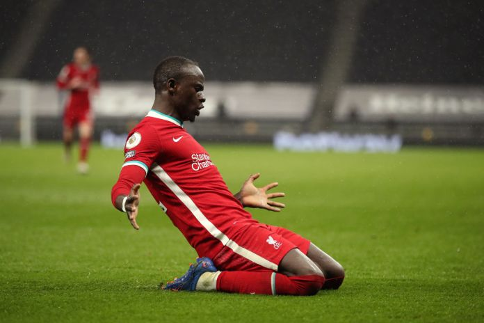 LONDON, ENGLAND - JANUARY 28: Sadio Mane of Liverpool celebrates after he scores his sides 3rd goal during the Premier League match between Tottenham Hotspur and Liverpool at Tottenham Hotspur Stadium on January 28, 2021 in London, England. Sporting stadiums around the UK remain under strict restrictions due to the Coronavirus Pandemic as Government social distancing laws prohibit fans inside venues resulting in games being played behind closed doors. (Photo by Nick Potts - Pool/Getty Images)
