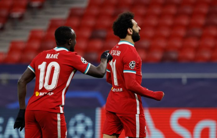 BUDAPEST, HUNGARY - MARCH 10: Mohamed Salah of Liverpool celebrates with team mate Sadio Mane after scoring their side's first goal during the UEFA Champions League Round of 16 match between Liverpool FC and RB Leipzig at the Puskas Arena on March 10, 2021 in Budapest, Hungary.