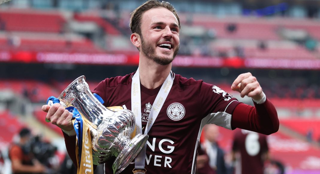 LONDON, ENGLAND - MAY 15: James Maddison of Leicester City holds the trophy as he celebrates after The Emirates FA Cup Final match between Chelsea and Leicester City at Wembley Stadium on May 15, 2021 in London, England.