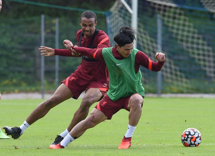 UNSPECIFIED, AUSTRIA - JULY 19:(THE SUN OUT, THE SUN ON SUNDAY OUT) Joel Matip of Liverpool with Takumi Minamino of Liverpool during a training session on July 19, 2021 in UNSPECIFIED, Austria. (Photo by John Powell/Liverpool FC via Getty Images)