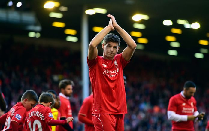 LIVERPOOL, ENGLAND - MAY 16: Steven Gerrard of Liverpool applauds the Kop end after he Barclays Premier League match betrween Liverpool and Crystal Palace at Anfield on May 16, 2015 in Liverpool, England. (Photo by Stu Forster/Getty Images)