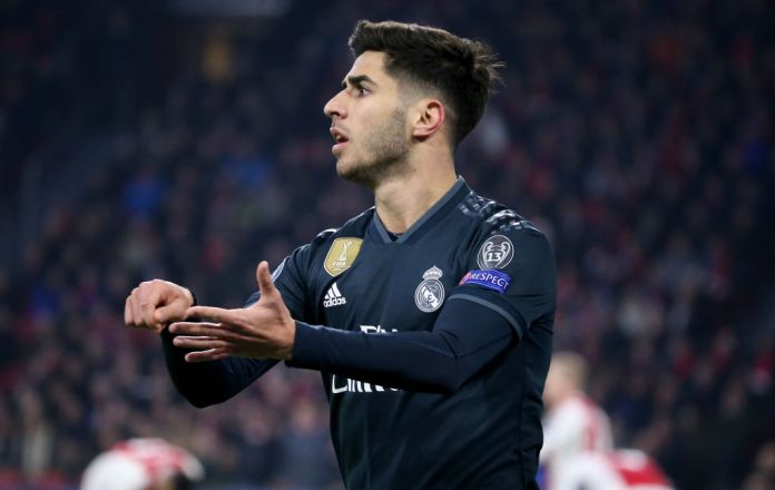 AMSTERDAM, NETHERLANDS - FEBRUARY 13: Marco Asensio of Real Madrid celebrates his goal during the UEFA Champions League Round of 16 first leg match between AFC Ajax Amsterdam and Real Madrid at Johan Cruyff Arena on February 13, 2019 in Amsterdam, . (Photo by Jean Catuffe/Getty Images)
