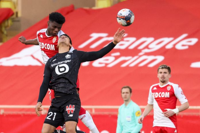 Monaco's French midfielder Aurelien Tchouameni 5L° fights for the ball with Lille's French midfielder Benjamin Andre during the French L1 football match between AS Monaco and Lille (LOSC) at the Louis II stadium in Monaco, on March 14, 2021. (Photo by Valery HACHE / AFP) (Photo by VALERY HACHE/AFP via Getty Images)