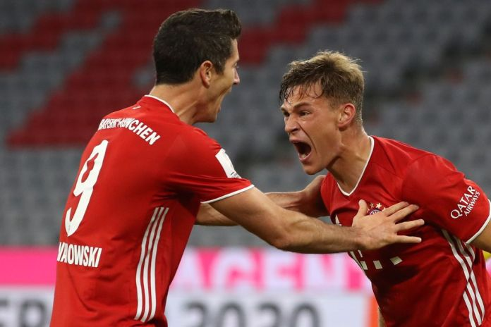 MUNICH, GERMANY - SEPTEMBER 30: Joshua Kimmich of FC Bayern Muenchen celebrates scoring the winning goal with his team mate Robert Lewandowski during the Supercup 2020 match between FC Bayern München and Borussia Dortmund at Allianz Arena on September 30, 2020 in Munich, Germany. (Photo by Alexander Hassenstein/Getty Images )