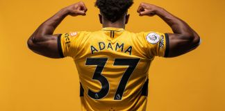 WOLVERHAMPTON, ENGLAND - AUGUST 03: Adama Traore of Wolverhampton Wanderers poses for a portrait in the Wolverhampton Wanderers 2021/22 Home Kit at Molineux on August 03, 2021 in Wolverhampton, England. (Photo by Wolverhampton Wanderers FC/Wolves via Getty Images)