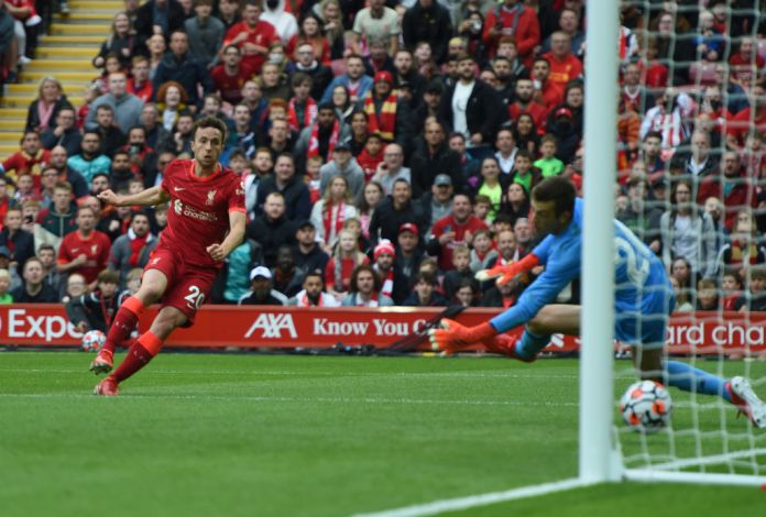 LIVERPOOL, ENGLAND - AUGUST 08: (THE SUN OUT,THE SUN ON SUNDAY OUT)Diogo Jota of Liverpool scores the first goal at Anfield on August 08, 2021 in Liverpool, England. (Photo by Nick Taylor/Liverpool FC/Liverpool FC via Getty Images)