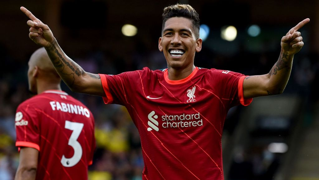 NORWICH, ENGLAND - AUGUST 14: (OUT, THE SUN ON SUNDAY OUT) Roberto Firmino of Liverpool celebrates after scoring the second goal during the Premier League match between Norwich City and Liverpool at Carrow Road on August 14, 2021 in Norwich, England. (Photo by John Powell/Liverpool FC via Getty Images)