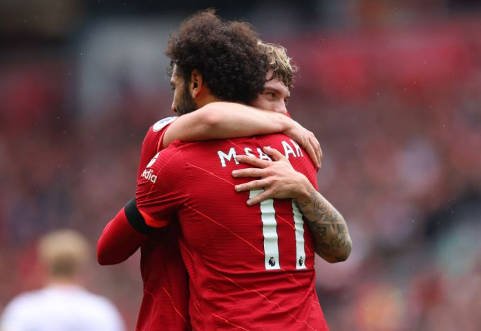 LIVERPOOL, ENGLAND - AUGUST 21: Mohamed Salah of Liverpool hugs Harvey Elliott during the Premier League match between Liverpool and Burnley at Anfield on August 21, 2021 in Liverpool, England. (Photo by Catherine Ivill/Getty Images)