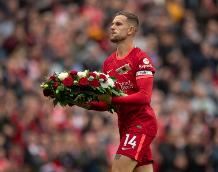 LIVERPOOL, ENGLAND - AUGUST 21: Liverpool captain Jordan Henderson lays a wreath in remembrance of all Liverpool supporters who have passed before the Premier League match between Liverpool and Burnley at Anfield on August 21, 2021 in Liverpool, England. (Photo by Visionhaus/Getty Images)