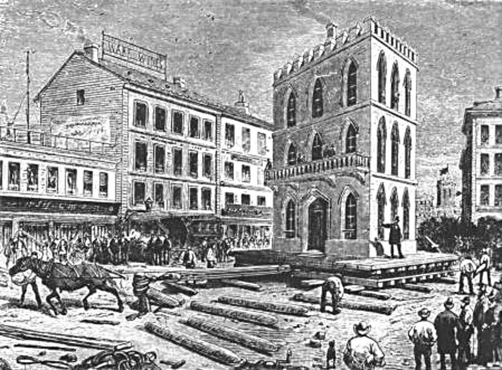 Sistema de gatos de tornillo utilizados en serie para elevar edificios en Chicago en el siglo XIX.