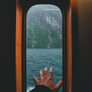 anonymous person inside of ship floating in sea