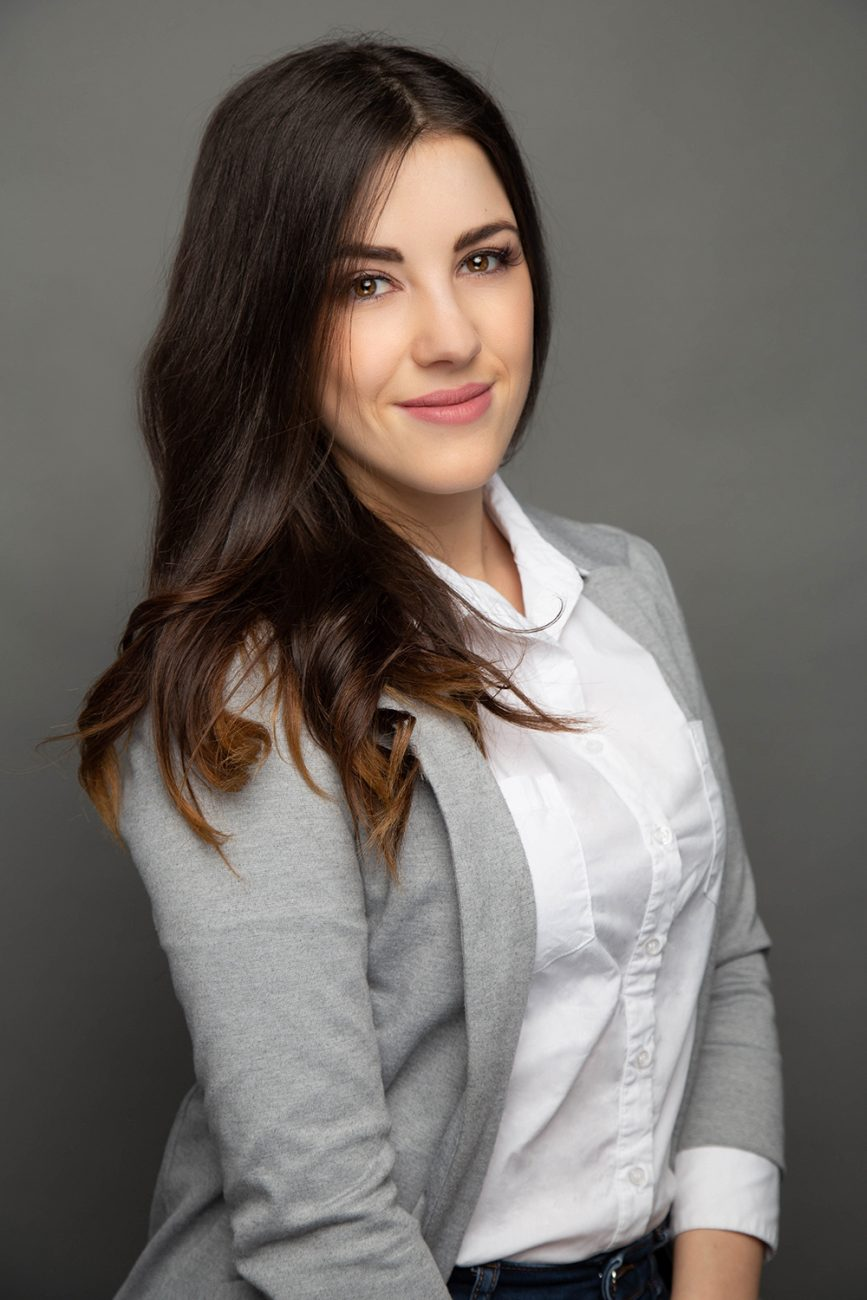 Caucasian woman wearing a suit for a business headshot