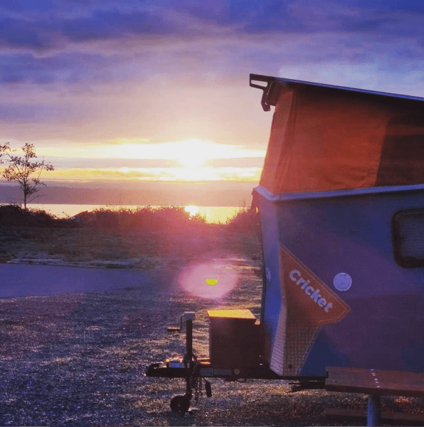Camper at sunrise overlooking Puget Sound
