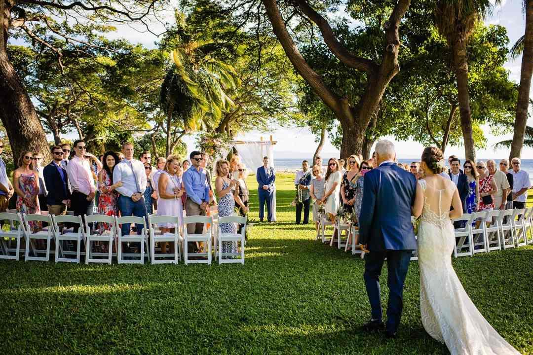 bride walking down aisle at olowalu plantation house