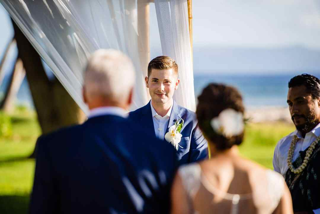 groom seeing bride during ceremony
