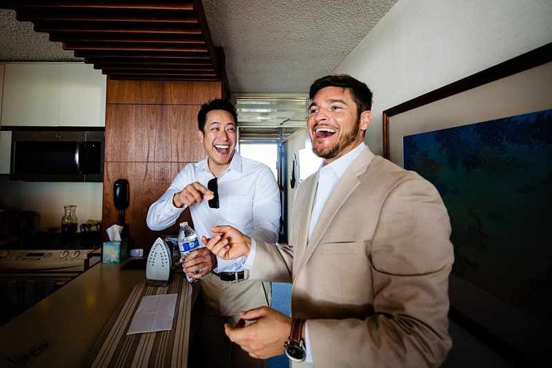 groom and groomsman laughing during getting ready