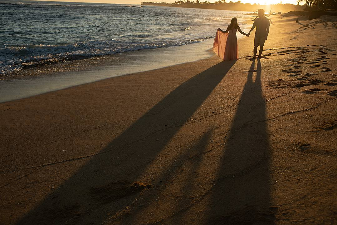 beach engagement photos with heart as shadows