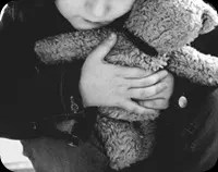 Kid hugging a teddy bear
